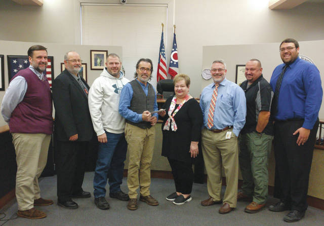 Champaign County Municipal Court personnel and local attorneys presented Caring Kitchen Executive Director Marilyn Cohn with a check for the Caring Kitchen Thursday after participating in No Shave November. To participate in No Shave November, the seven participants donated $50 towards the Caring Kitchen. The participants from left to right included Attorney Kirk Ellis, Municipal court bailiffs Carl Bader and Kip Michael, Judge Gil S. Weithman, Municipal Court Prosecutor Mark Feinstein, Municipal Court Probation Officer Brian Cordial, and Municipal Court Assistant Prosecutor Roger Steffan.