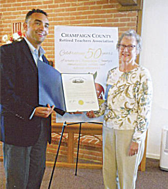 Ohio State House Representative Nino Vitale and CCRTA President Karen Headlee celebrate a proclamation honoring the CCRTA's 50th anniversary.