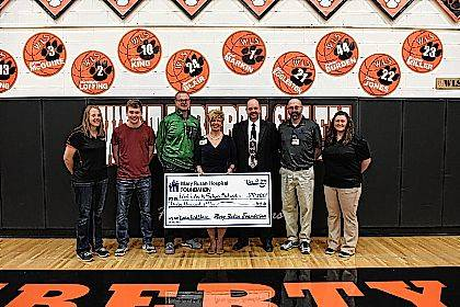 Attending the check presentation were, from left, Athletic Association Officer Jamie Harrison, Logan Cole, Athletic Director Jake Vitt, MRH Community Relations VP Tammy Allison, Superintendent Kraig Hissong, MRH Athletic Training Supervisor Ed Wisner and WL-S Athletic Trainer Nicki Clark.