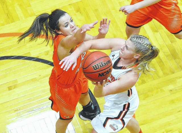 Ohio Northern University's Lindsey Black – a Graham High School graduate – puts up a shot against Heidelberg's Maggie Davault during a game last season at the King Horn Center in Ada.