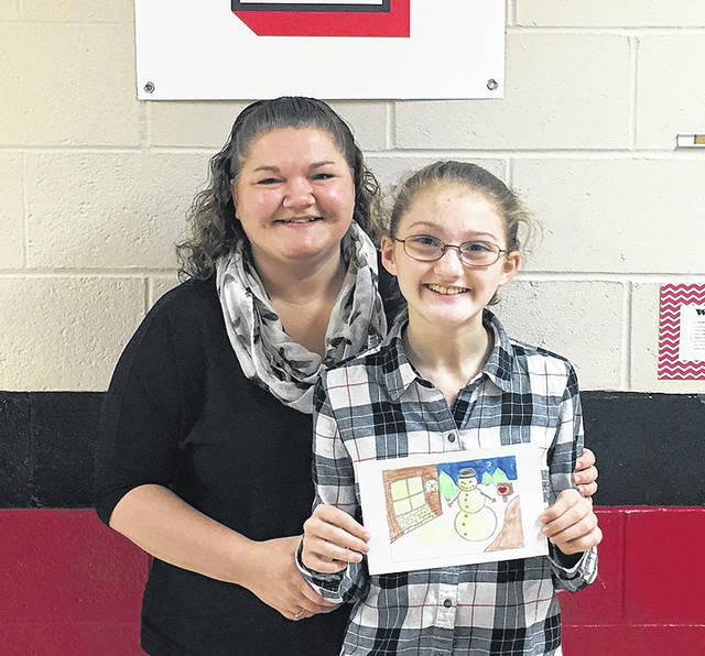 Paige Davis, a sixth grader at Triad Middle School in North Lewisburg, was the winner of Memorial Health's 2017 Holiday Card design contest for students in the fifth and sixth grades. Paige received a $50 gift card from Memorial Health. Here Paige is shown with her mother Jessica Dennison and her winning design. This is the tenth straight year for Memorial's annual holiday card design contest with local schools.