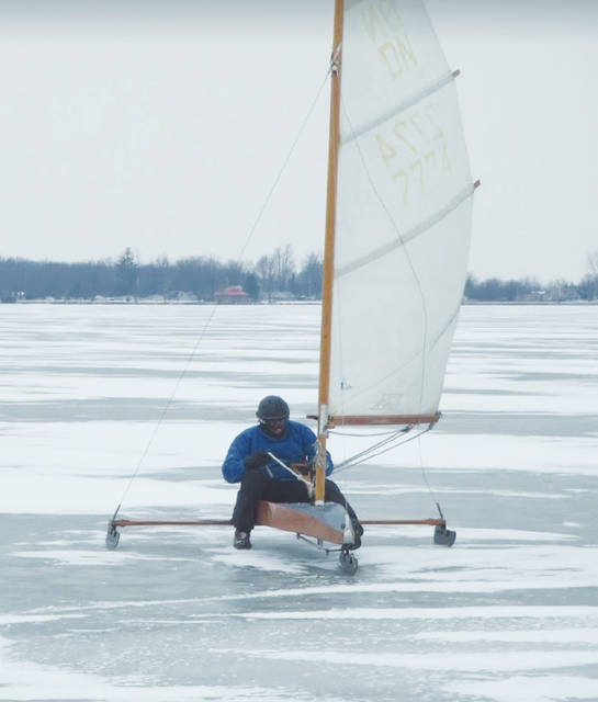 Expert local ice boater Jeff Patten skims across the ice at Indian Lake.