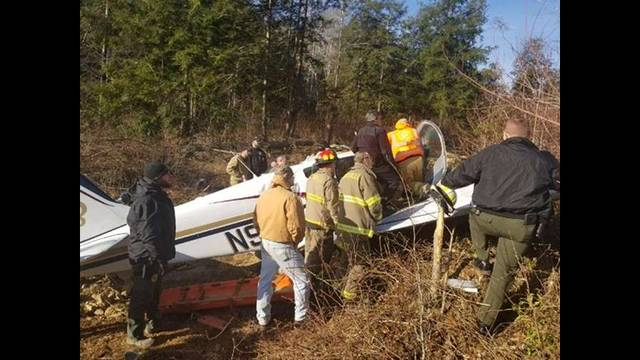 Photo courtesy of WBIR.com TV In this photo from WBIR TV, investigators and emergency workers are shown on Wednesday with a small plane that crashed in eastern Tennessee this week. The plane was carrying the parents of Erin Patton, an insurance agent in Urbana.