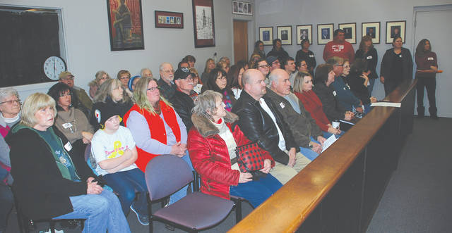 Close to 50 people filled the standing room only Urbana City Council chambers Tuesday. Many wore stickers protesting the proposed ban on feeding feral cats, deer, geese and other animals.