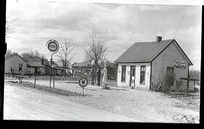 Then - This circa 1930 photo is of Basil Spain Pure Oil Gas Station, 344 E. Maple St. (corner of East Maple and Cherry Streets), North Lewisburg (Champaign County Historical Society #0010). The building was the residence of Christina Vance from 1900 to the 1920s. She made and sold rugs. Basil and Onda Spain purchased the house and converted it into a Pure Oil Gas Station in 1930. They operated the business for 39 years.