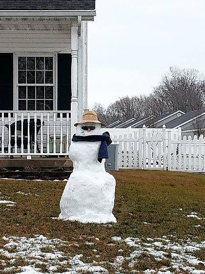 This snowman, all decked out in shades, a scarf and a hat, greets passersby on East Lawn Avenue in Urbana on Wednesday morning. The snowman might shrink a little in the rain on Thursday, but what's left of him will enjoy the snow and bitter cold that is expected to return after this brief warm spell.