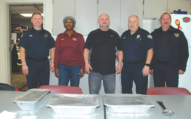 The owners of Don's Auto Service delivered a homemade lunch of ribs and potato salad to Champaign County sheriff's deputies and to Urbana Police and Fire division personnel on Tuesday. This is the third year that co-owners Michele Adams and Don Napier delivered the lunches in appreciation of the service of first responders. From left are Ron Lyons, firefighter and Emergency Medical Technician, Adams, Napier, Dean Edwards, firefighter and paramedic, and fire Capt. Eric Beverly.