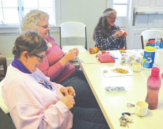 From left, Janet Goebel, Bea Ward and Kim O'Connnor participate in knitting time at the St. Paris Public Library on Tuesday. The library has been offering knitting sessions for all ages. For info, call the library at 937-663-4349.