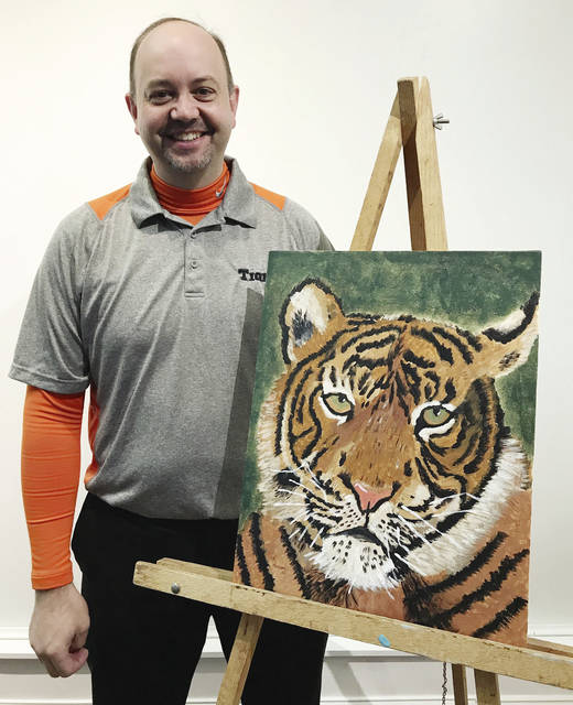 """Bad"" Artist Kraig Hissong shows his Eye of the Tiger on canvas. Hissong is superintendent of West Liberty-Salem schools."