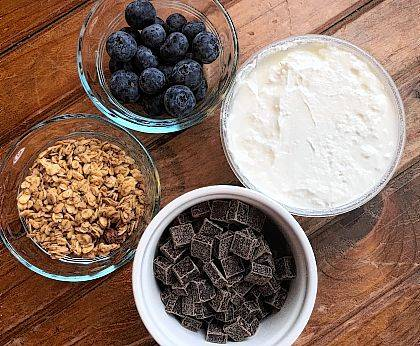 Blueberries, Greek-style yogurt, whole-grain granola and high-percentage cacao dark chocolate chunks might make a healthy breakfast that's also yummy. Just take it easy on the chocolate. Avacados and salmon for dinner will complete the heart-healthy dining for the day.