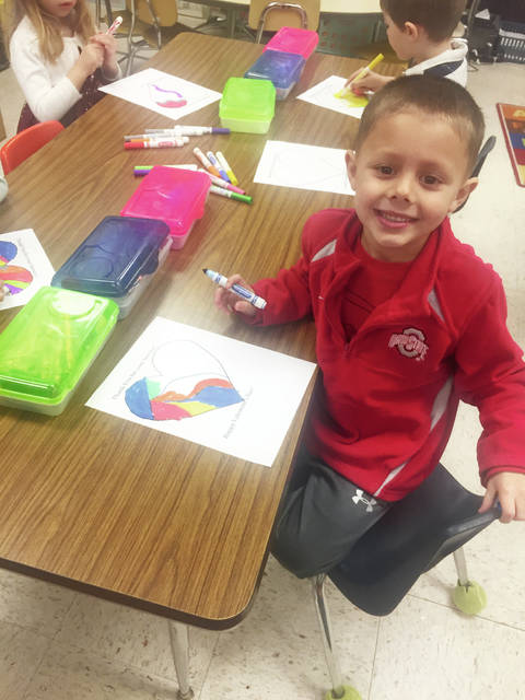Matthew Arnett of Mrs. Kay Trout's class shows his creation for Operation Valentine. He is a student at Urbana North Elementary.