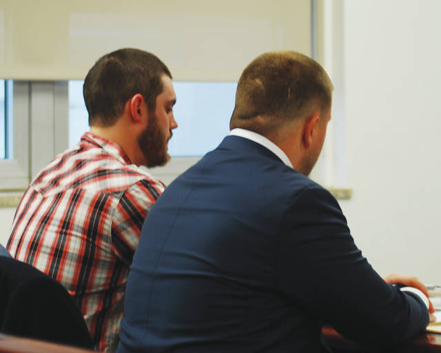 Dylan W.G. Lambert, left, appeared in court Wednesday sitting next to his attorney, Nathan Stuckey. Lambert was indicted this month on 10 charges, including two counts of aggravated vehicular homicide, stemming from a Nov. 3, 2017, crash that resulted in the death of Sara Hess, 15, and injured two other people.