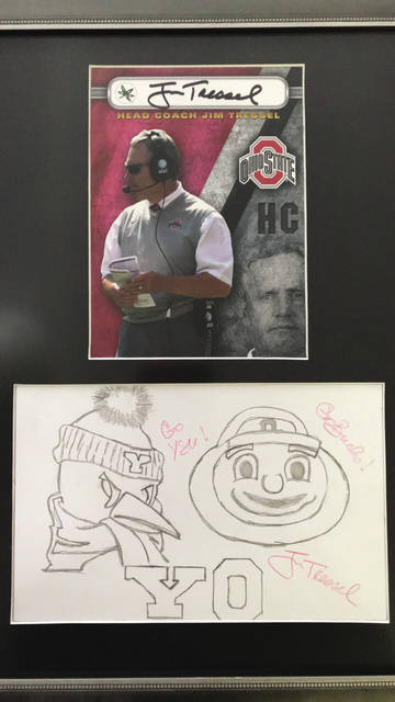 Former Ohio State football coach Jim Tressel is one of the contributors to this year's Bad Art by Good People fundraiser, which benefits the Champaign County Arts Council. Tressel's signed pencil artwork features Brutus Buckeye and the Youngstown State University Penguin, and the framed piece includes an autographed photo depicting him from his coaching tenure at Ohio State.
