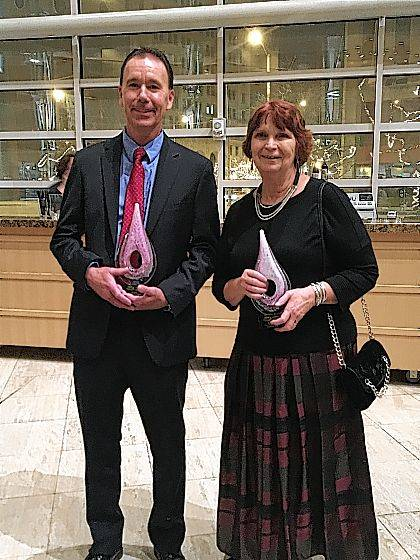 Jeff Ayres, left, and Sandy Crow, right. hold their awards.