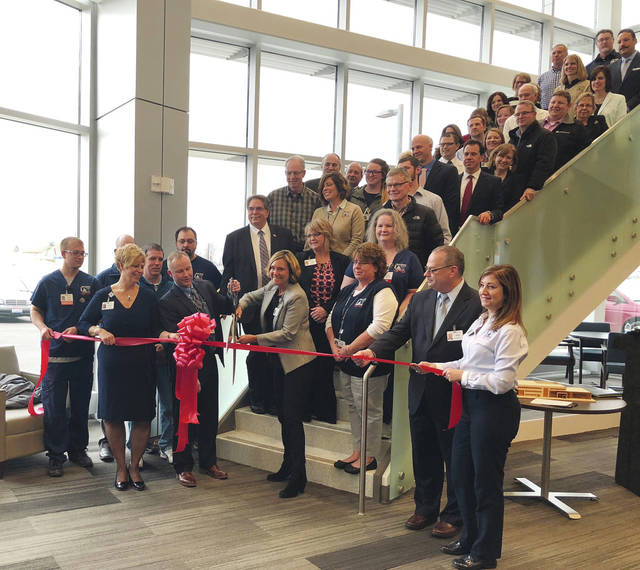 Local leaders cut the ribbon at the new Mary Rutan Health Center in Bellefontaine on Thursday.