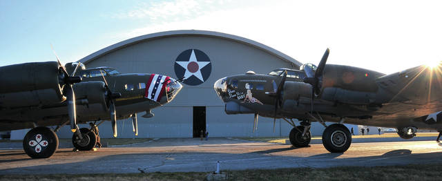 Iconic B-17 Flying Fortress <em>Memphis Belle</em>, left, poses for photos along with <em>Shoo Shoo Baby</em> at the National Museum of the United States Air Force earlier this week.