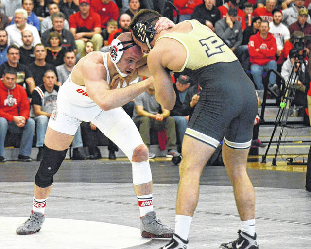 Ohio State senior and former Graham standout Bo Jordan (left) finished fifth at the NCAA wrestling championships over the weekend at 174 pounds. The Buckeyes finished second behind Penn State.