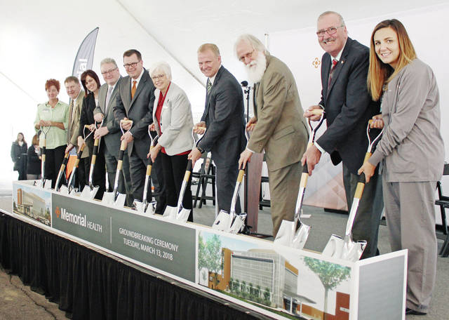 Shown at the March 13 groundbreaking for Memorial Health's inpatient and outpatient pavilions (left to right): Tabbi Thompson, Memorial employee representative; Marysville Mayor J.R. Rausch; Bobbie Trittschuh, Executive Director, Honda of America Foundation; Dr. Charlie Muncrief, President, Memorial Hospital Medical Staff; Chip Hubbs, President/CEO, Memorial Health; Nikki Conklin, Chair, Memorial Health Board of Trustees, and Co-Chair, Memorial 2020 Capital Campaign; Chad Hoffman, Trustee, Memorial Health Board and Co-Chair, Memorial 2020 Capital Campaign; Steve Stolte, Union County Commissioner; Henk Berbee, Vice-Chair, Memorial Health Foundation; and Samantha Rhodeback, Memorial employee representative.