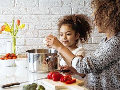 Let kids help in the kitchen during meal preparation. Other ways to encourage kids into healthy eating habits is to eat more meals at home and to introduce food of different cultures.