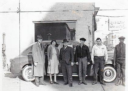 This is a November 1940 photo of the Urbana Motor Sales, A. T. Pickrell proprietor. The business was located at the NW corner of W. Market and S. Main streets in Urbana. Later Mr. Pickrell moved his business to a location on N. Main Street. In the photo (left to right) are A.T. Pirkrell, Marjory Blair, Hugh Brackney, Earl Hall, unidentified person and Sam McGregor. Currently this building at 122 S. Main St. is the location of PB&amp;J on Main (vintage &amp; collectibles). The Champaign County Historical Society thanks Donna Lu (Pickrell) Ward for sharing this photo of her father. <em>The Champaign County Historical Society is an all-volunteer, not-for-profit organization that preserves, protects, archives and displays the artifacts that tell Champaign County&#8217;s history. The society operates on donations and dues and has a free public museum of history at East Lawn Avenue in Urbana</em>