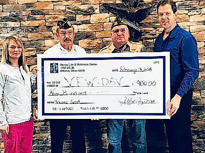 The Donay Life & Wellness Center, 1598 E. U.S. Route 36, Urbana, donated $900 to the VFW/DAV Hall, Urbana, following a November 2017 promotion in which new patients were offered a consultation, exam and xrays for $30, all of which was donated to the veterans' hall. In the photo, Brittany Hardwick, Fred Williams, Tony Marking and Dr. Jeffrey Donay hold the presentation check.