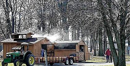 Wagon tours take visitors to the sugar shacks where all the action occurs at the Maple Syrup Festival at Indian Lake State Park.