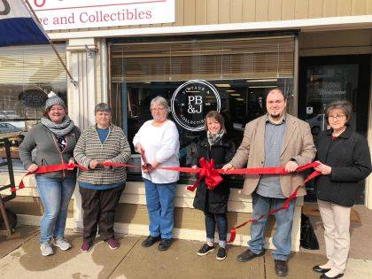 The Champaign County Chamber celebrated the grand opening of PB&J, 122 S. Main St., Urbana, with a ribbon-cutting April 7. Pictured are Michelle Moore, co-owners Polly Shonkwiler and Janice Shonkwiler, Chamber Director Lydia Hess, Brandon Nichols and Ellen Pond. The store has a little bit of everything - from furniture to small collectibles.