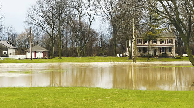 This house on state Route 560 south of Westville was inundated by an overflowing creek on the property after Monday's melting snow and Tuesday's heavy rains. It is one of three similar and historic houses built along the creek in Mad River Township, two of which are often threatened by rising floodwaters during heavy storms. The house across the road was also threatened by the rising creek and its owners could not travel down the driveway toward the house until the water receded.