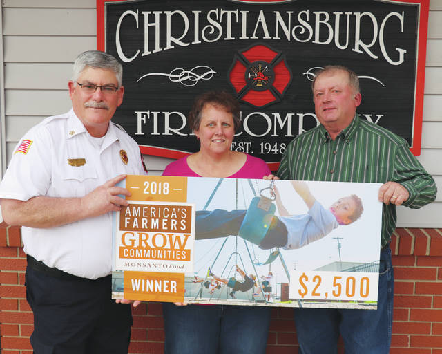 The Christiansburg Fire Company received a donation from local residents Richard and Gloria Bodey through a program sponsored by the Monsanto Fund. Christiansburg Fire Chief Bob Hoey, left, said the donation will go toward equipment for grain bin and rope rescue.