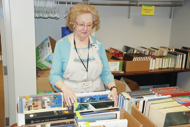 Lucy Bishop volunteers on Friday evening at the annual Friends of the Library Book Sale. The sale was being held at the Champaign County Library in Urbana.