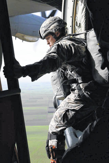 Urbana High School alumnus Sgt. 1st Class Matthew Deane, currently a ranger instructor with the Army's 5th Ranger Training Battalion, prepares to jump from an airplane on one of his 68 jumps.
