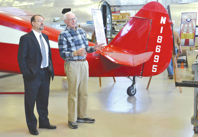 Volunteer Bill Albers, right, gives Jeff Duford, left, a tour of the Champaign Aviation Museum during his visit April 26.