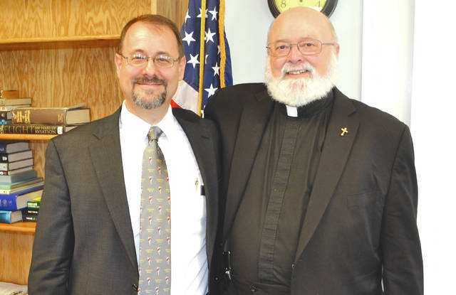 Jeff Duford, left, curator of the National Museum of the U.S. Air Force, stands by his father, Rev. Dr. Don Duford, right, priest-in-charge of the Episcopal churches in Urbana and Mechanicsburg, following Jeff's lecture at the Champaign Aviation Museum on April 26.