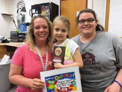 Meghan Hoskins is an Urbana Student of the Month in Mrs. Miesse's class. On the right is Paraprofessional Ms. Preece.