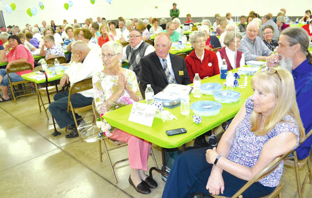 """Arletha Joy """"Jo"""" Frasure was named Champaign County's Outstanding Senior Citizen of the Year on Tuesday at the county fairgrounds. Frasure was joined by six of her classmates from Urbana High School's class of 1954, as well as members of the Urbana Champaign County Senior Center, for a full day of activities that began with a senior support services expo, followed by lunch, then entertainment by the UCCSC Line Dancers, The Dancing Dolls and the Urbana High School Show Choir. Urbana Mayor Bill Bean read a proclamation declaring May as Older Americans Month and thanked Frasure for her service on the UCCSC Board and the Oak Dale Cemetery Board, and for her volunteer service at Vancrest of Urbana, Sycamore House, the Community Thrift Store and elsewhere."""