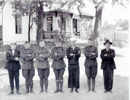Then – Upon the 100-year anniversary of the end of World War I we recognize five Urbana brothers who served in that war. This is a 1918 photo (#0648) of William Egan Sr. and six sons, five of whom served in World War I. The photo was taken in front of their home at 154 W. Light St., Urbana. From left to right are Richard, who was too young for service; Frank, U.S. Army; Henry U.S. Army; Joseph, U.S. Marine Corps; William Jr., U.S. Navy; John, U.S. Army; and William Sr., who kept the home fires burning while awaiting his sons' return. (Urbana Daily Citizen, June 24, 1976) Of the sons who served Frank was the youngest and John was the oldest. Sergeant Joseph Egan was injured while serving in France. As reported in the Urbana Daily Democrat on November 5, 1918, Mr. Egan, during a recent Liberty Loan campaign, was presented a service flag containing five stars representing his five sons who were in the service. Undoubtedly Mr. Egan was extremely proud of his sons for their service in World War I.