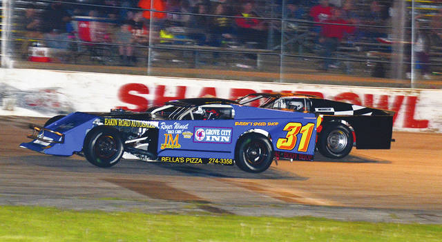Buddy Townsend of Columbus competes against West Liberty's Logan McPherson during a recent race at Shady Bowl Speedway.