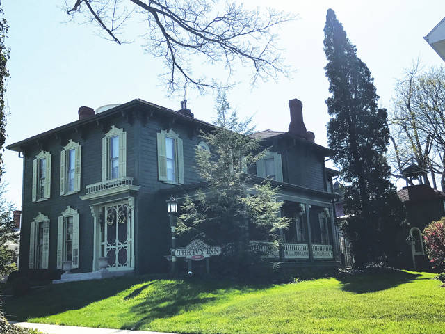 "The beautiful Italianate frame house at 322 N. Springfield St. is now known as ""The Ivy Inn,"" a bed and breakfast."