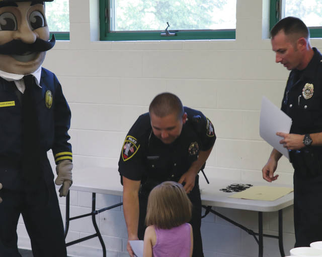 Children participating in the Urbana Police Division's annual Safety Town program graduated June 15 during a ceremony in Melvin Miller Park. Children were greeted during graduation by Urbana Police Sgt. Jason Kizer, Officer AJ Ervin and Urbana Police Mascot Officer Stanley. The graduation marked the end of the first week of this year's program.