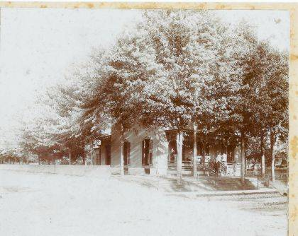 Then - This is a circa 1898, photo of Dr. Joseph V. Longfellow residence at 907 South Main, Urbana, Ohio. View is looking from northwest at the intersection of South Main Street and Powell Avenue, with white picket fence on the Powell Avenue side of the property. The people in the photo are not identified. It is likely Dr. Longfellow and his family. The property included a large impressive yard with a fountain, flowers and trees. (#'s 1986 through 1999) Joseph V. Longfellow was born on a farm in Concord Township in 1858. He attended Ohio Wesleyan University in Delaware, Ohio and then the Miami Medical College in Cincinnati graduating in the class of 1886. Soon afterward he practiced medicine in Eris. After four years he located his practice in Urbana. After several years of practice in Urbana, ill health compelled him to retire. A Centennial Biographical History of Champaign County, Ohio, 1902 and History of Champaign County, Ohio, by Judge Evan P. Middleton, Vol1, 1917, p. 369.