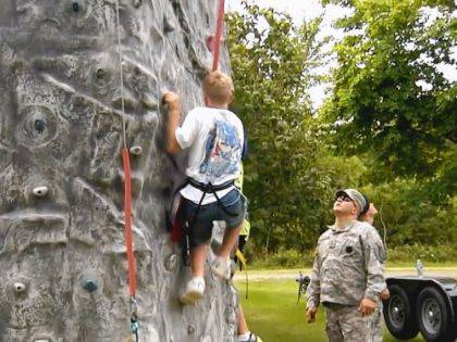 A camper practices rock climbing skills at the Ohio 4-H Military Camp.