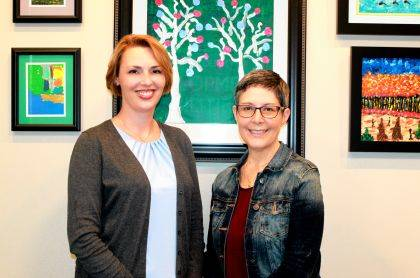 Leigh Anne Wenning, left, and Laura Zureich pose for a photo at the Champaign County Board of Developmental Disabilities.