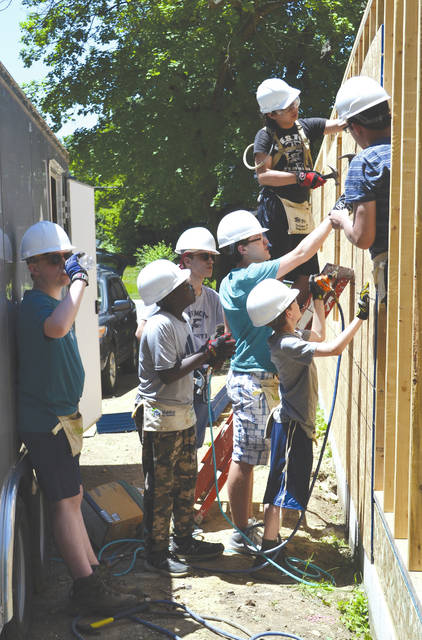 Eleven students from the St. George Episcopal Youth Group in Dayton are in Urbana this week performing a Youth Build at the Habitat for Humanity home at 517 S. Main St. The sixth through 12th graders are staying at Urbana University until Thursday and plan to spend several hours a day volunteering to construct the home.