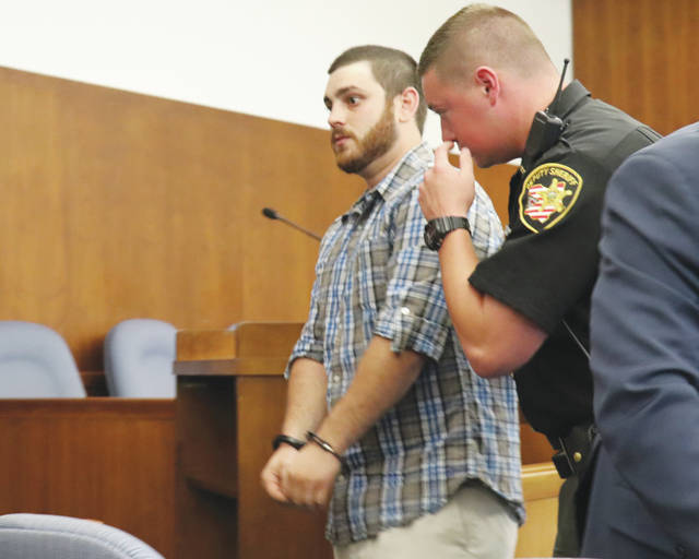 Dylan W.G. Lambert is taken into custody Monday following a sentencing hearing in the Champaign County Common Pleas Court. Lambert, 28, received a 10-year prison sentence along with a lifetime driver's license suspension for his conduct on Nov. 3, 2017, which led to a fatal crash.