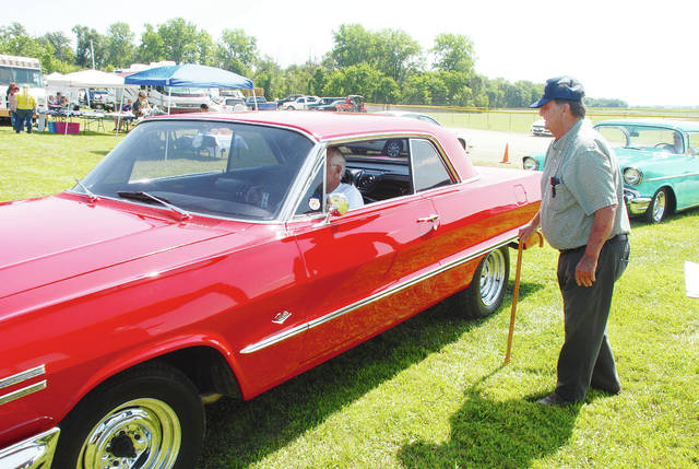Dick Kizer (right) checks in Dick Martin in his 1963 Chevy during the Classic Car Cruise-In at Summerfest on Saturday at Concord Community Center. The annual event was held Friday and Saturday and included an array of offerings and activities.