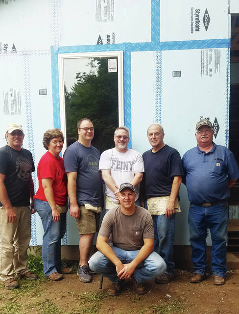Habitat for Humanity Champaign County Ohio (HFHCCO) received support from city of Urbana staffers on the Habitat build this past weekend. Volunteers, from left, Chad Hall, Chris Boettcher, Doug Crabill, Mark Feinstein, Kerry Brugger, Joe Sampson and Brad Yost (in front) assisted with the completion of roofing, installation of windows, application of exterior blue board, and shed roofing. Habitat expressed appreciation for Brugger's leadership and willingness to assist with HFHCCO's 10th home. Coppertop provided sirloin burgers and fries while Patty Brown baked pies for dessert. Orbis will be HFHCCO's volunteer build crew next week.