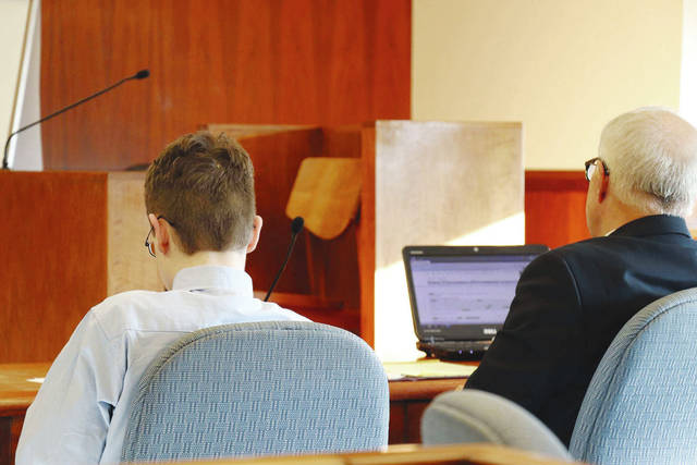 Donovan Nicholas, left, sits with Attorney Darrell Heckman Wednesday evening after a jury found him guilty of aggravated murder and murder. A sentencing hearing is scheduled for Tuesday.