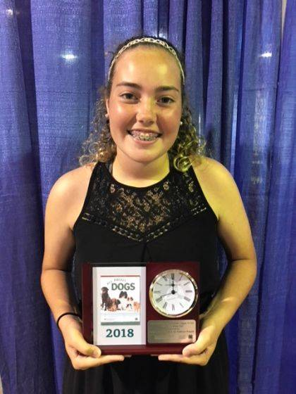 """Anna Selvaggio won the Clock Trophy for her """"All About Dogs"""" project at the state fair. While at the state fair she was also awarded an Outstanding of the Day ribbon for her Sewing for Middle School project."""
