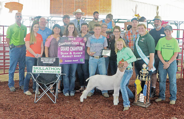 Emmalee Cecil's Champion Born and Raised Goat sold for $1,275 to a syndicate of buyers.