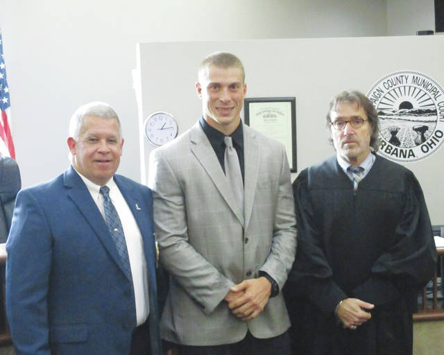 Officer Keith Hurst was sworn in as the newest member of the Urbana Police Division Tuesday. A 2009 graduate of Mechanicsburg High School, Hurst was employed as a corrections officer at the Tri-County Jail when hired. From left are Police Chief Matt Lingrell, Hurst and Judge Gil Weithman.